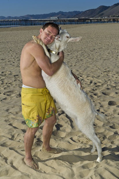 Hugging with a pet goat