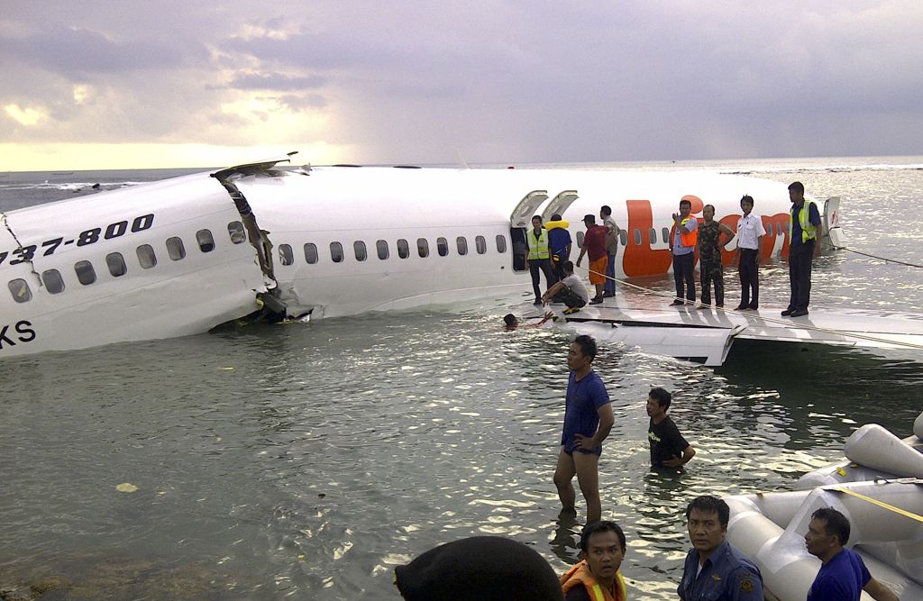 Rescuers look through the plane