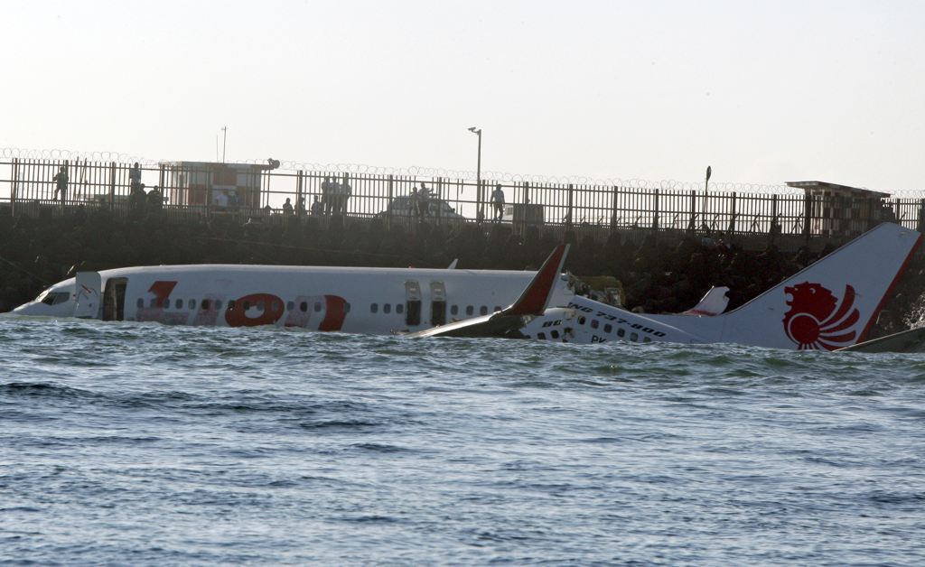 The wreckage of a Lion Air jet sits in the ocean near the airport in Bali, Indonesia