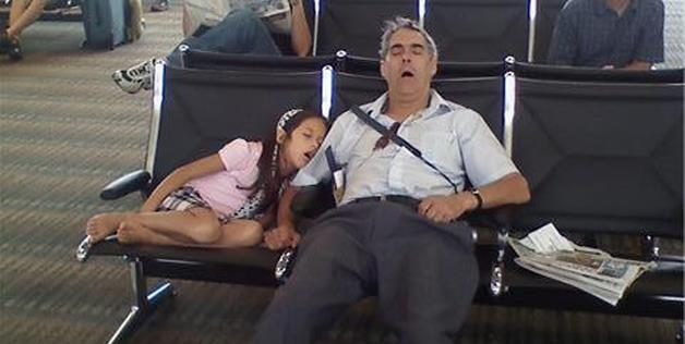 A nice nap with the family at the airport.