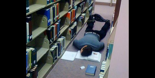 That book must have been very boring. No better place to sleep than on the library floor.
