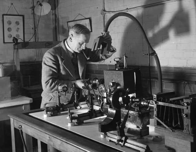 A man working with laboratory equipment, 1943