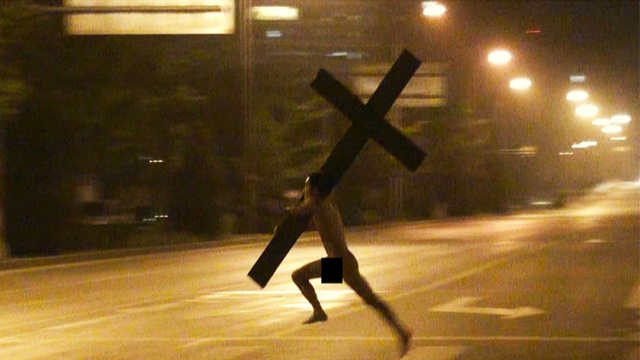 Just A Naked Chinese Dude With A Cross, Nothing Outrageous Here.