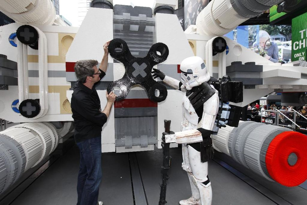LEGO Master Builder Erik Varszegi and members of the 501st inspect the thrusters