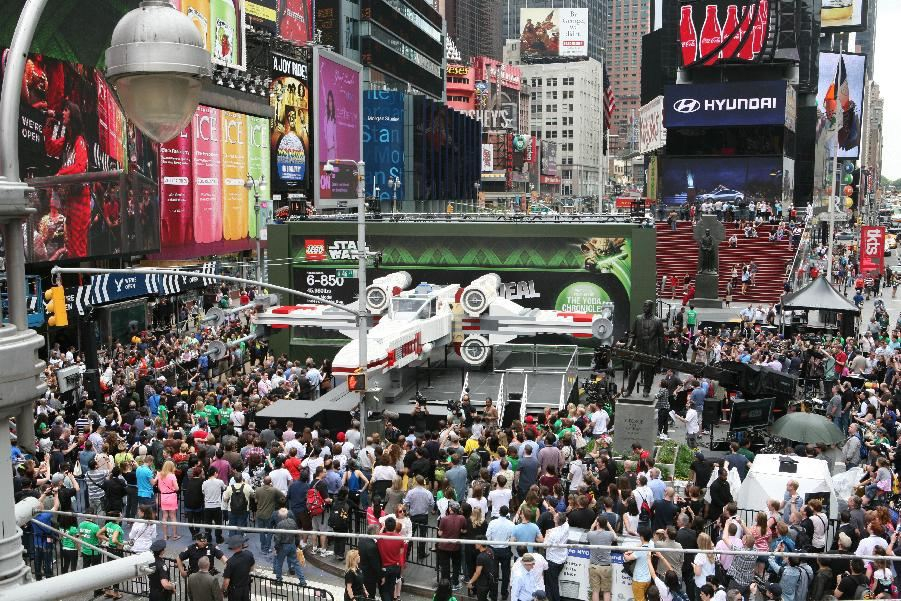 Thousands gather in New York City's Times Square to watch the unveiling of the world's largest LEGO Model