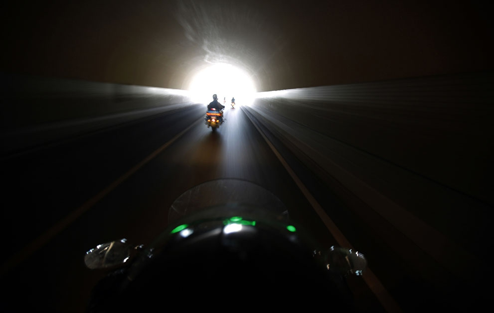 Harley Davidson riders pass through a tunnel during the annual rally in Qian Dao Lake, on May 11, 2013.