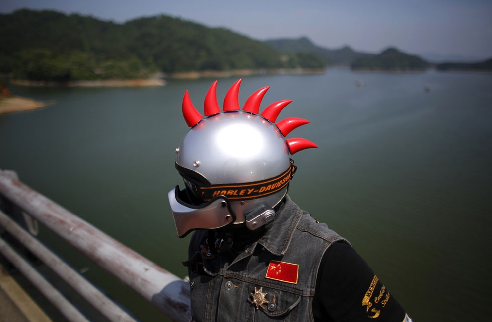 A Harley Davidson rider with decorated helmet takes a break in Zhejiang Province, on May 11, 2013.