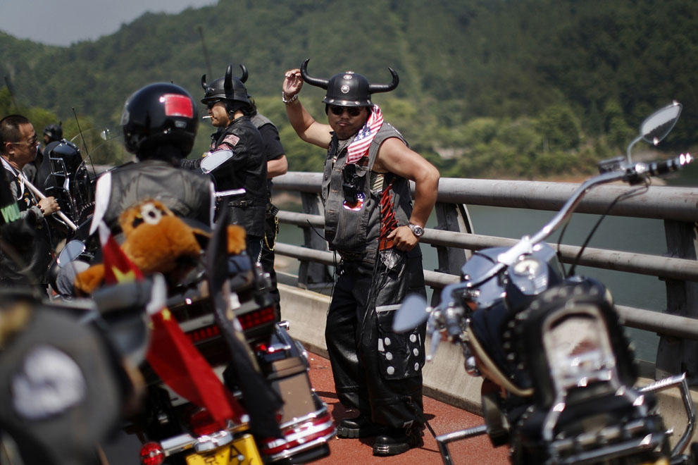 A Harley Davidson fan dances during the annual rally in Qian Dao Lake, on May 11, 2013.