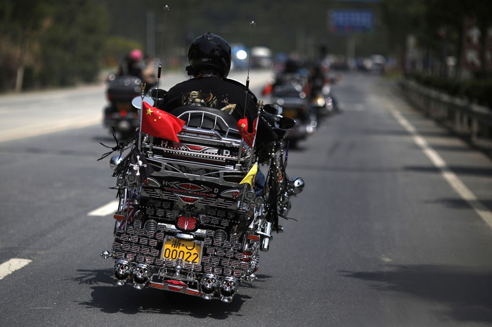 A man rides a decorated Harley Davidson in Qian Dao Lake, on May 11, 2013.