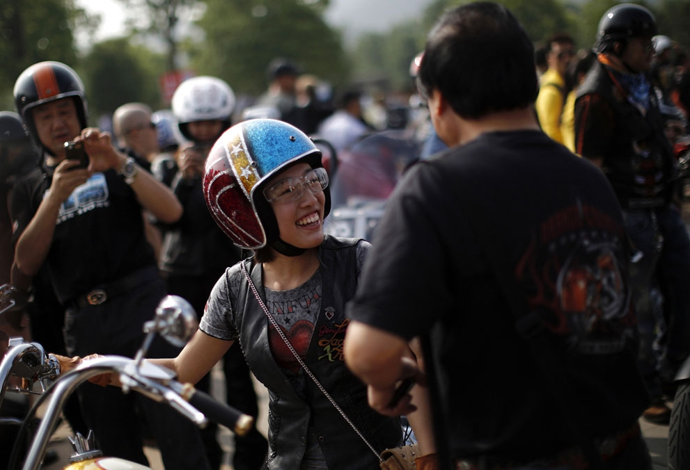 A woman attends the annual Harley Davidson National Rally in Qian Dao Lake, China, on May 11, 2013.