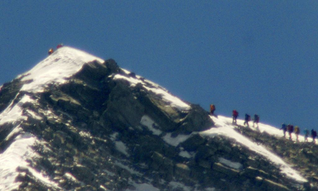 A team of climbers, led by 80-year-old Japanese mountaineer Yuichiro Miura approach the summit