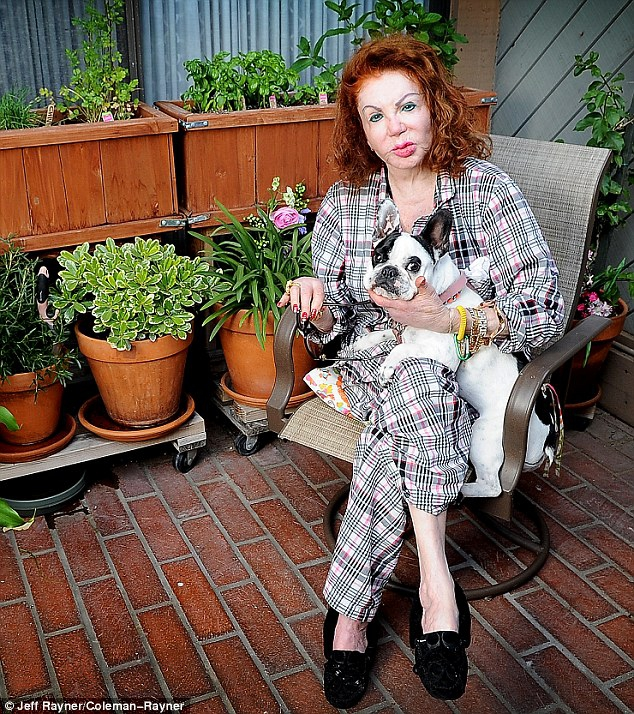 Jackie Stallone relaxes in her Santa Monica home with her dog GG