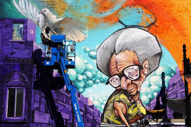 Huge Mural of a Graffiting Grandma in Montreal