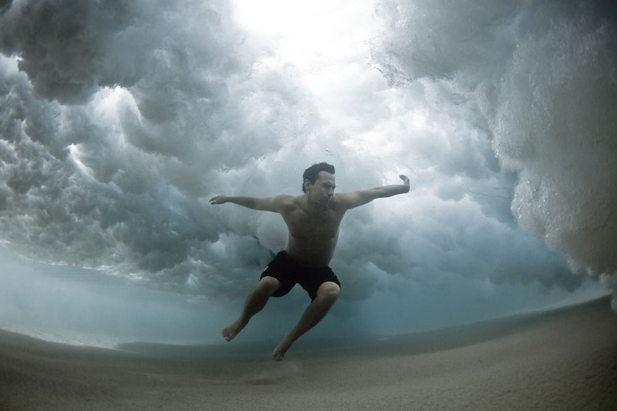 Stunning Underwater Photos of People Fighting Against the Ocean