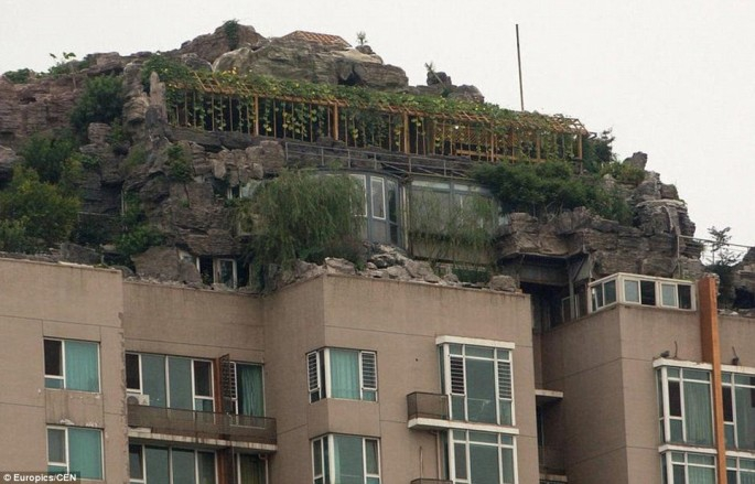 An Illegal Mountain Retreat On A 26 Story Apartment Block Built By A Beijing Professor.