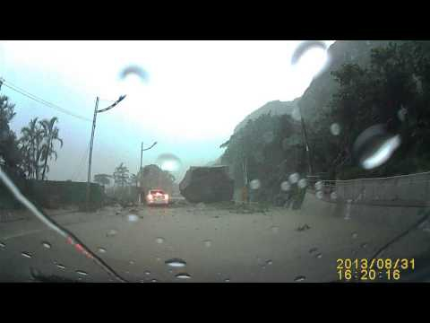 A Car Nearly Crushed by a Huge Boulder in a Landslide in Taiwan